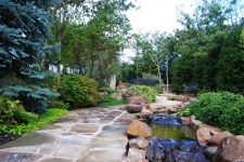 Stream, flagstone path, and landscaping