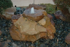 Stacked boulder fountain