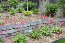 Stacked flagstone retaining wall