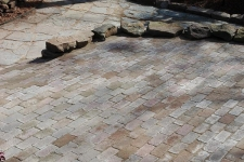Flagstone path, brick paver patio, and rock walls