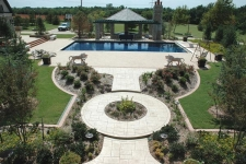 Elevated view of hardacape, pergola, and landscaping