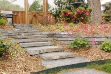 Stacked stone retaining wall and steps